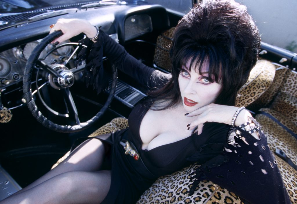 elvira in her car